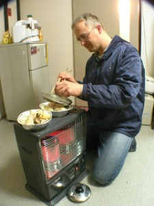 Cooking with Kerosene Heater - This guy prepared early